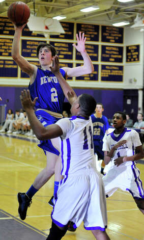 Newtown's Connor Quinn shoots over Westhill's Guyveson Cassamajor during their game at Westhill High School on Wednesday, March 6, 2013. Photo: Jason Rearick / The Advocate