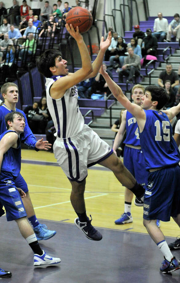 Westhill's Evan Skoparantzas shoots a fade-away jumper in front of Newtown's Gavin Scallon during their game at Westhill High School on Wednesday, March 6, 2013. Photo: Jason Rearick / The Advocate