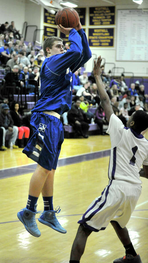 Newtown's Julian Dunn shoots over Westhill's Jeremiah Livingston during their game at Westhill High School on Wednesday, March 6, 2013. Photo: Jason Rearick / The Advocate