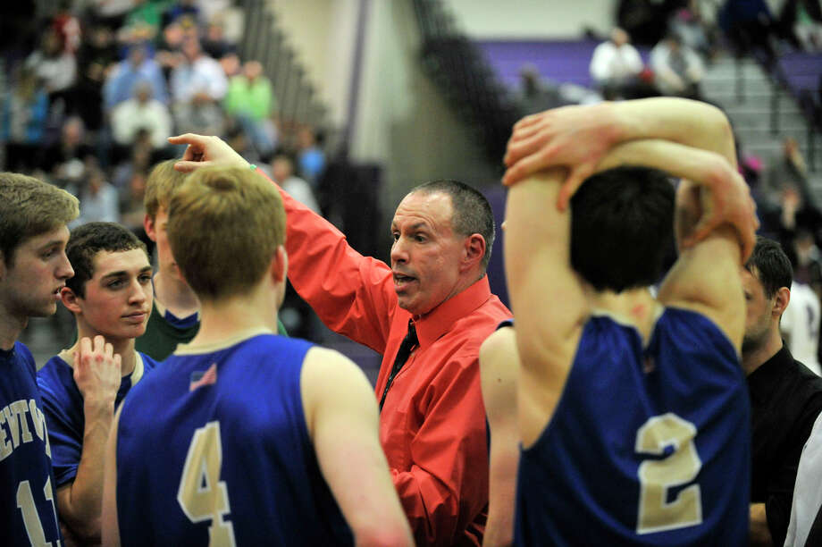 Newtown head coach Tim Tallcouch talks to his team during a break in the action in the Nighthawk's game against Westhill at Westhill High School on Wednesday, March 6, 2013. Westhill won, 56-34. Photo: Jason Rearick / The Advocate
