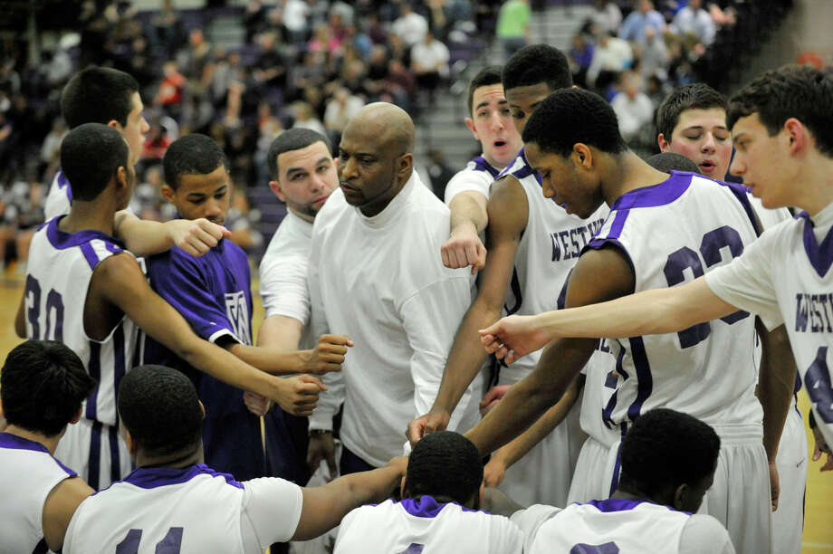 Westhill head coach Howard White talks to his team during a break in the action in their game against Newtown at Westhill High School on Wednesday, March 6, 2013. Photo: Jason Rearick / The Advocate