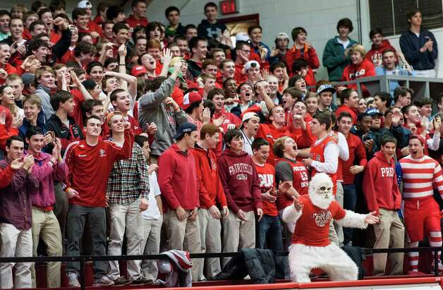 Fairfield Prep fans cheer on their team during a second round 2013 CIAC class LL boys basketball tournament game against Newington high school held at Alumni Hall, Fairfield University, Fairfield CT on Wednesday March 6th 2013. Photo: Mark Conrad / Connecticut Post Freelance