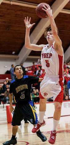 Thomas Nolan, Fairfield Prep, reaches for a rebound in a second round 2013 CIAC class LL boys basketball tournament game against Newington high school held at Alumni Hall, Fairfield University, Fairfield CT on Wednesday March 6th 2013. Photo: Mark Conrad / Connecticut Post Freelance