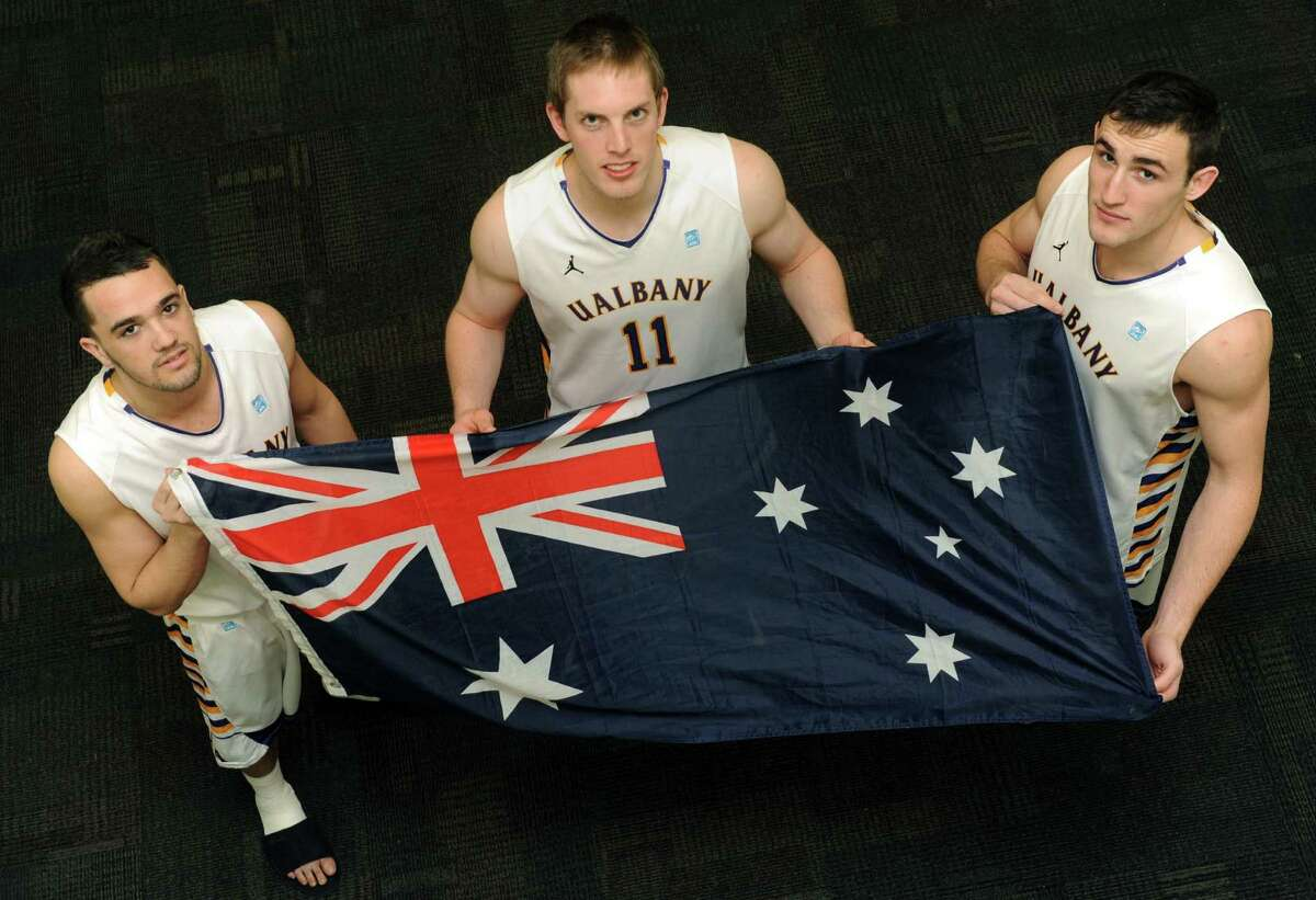 UAlbany basketball players Peter Hooley, Luke Devlin and Sam Rowley who are all from Australia hold the Australian flag on Friday Feb. 15, 2013 in Albany, N.Y. (Michael P. Farrell/Times Union)