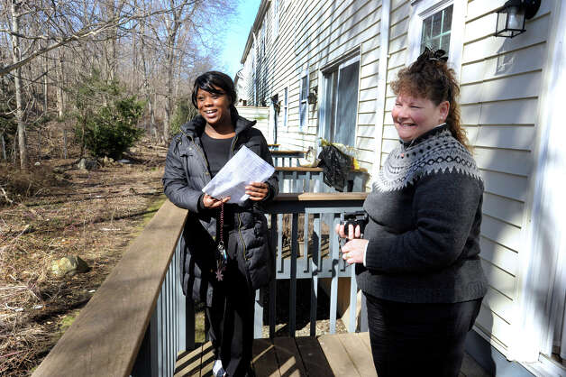 Ranisha Green, 25, left of Danbury, and  Carolyn Ridenour, 47, look at the view off the back patio of an apartment in Danbury, Conn., that Green could possibly rent, Tuesday, March 5, 2013. Ridenour works for Prudential Connecticut Realty. Photo: Carol Kaliff / The News-Times