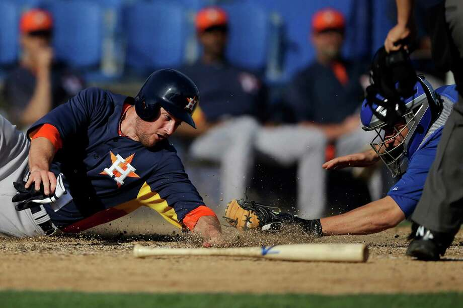 In one of his rare opportunities to see the field this spring, the Astros' Trevor Crowe, left, is tagged out at home by the Blue Jays' Josh Thole in a Feb. 27 game. Photo: Matt Slocum, STF / AP