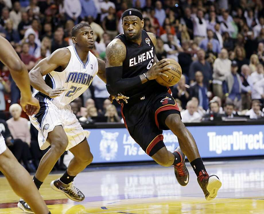 Miami's LeBron James drives past Orlando's DeQuan Jones en route to scoring the game-winning layup with 3.2 seconds left. Photo: J Pat Carter, Associated Press