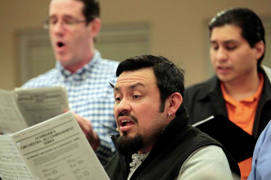 (center) John Mendoza sings as part of the choir at St. Anne Catholic during rehearsal Tuesday, February 26, 2013 at At. Anne Catholic Church in Houston, Texas. Photo: Billy Smith II / Houston Chronicle