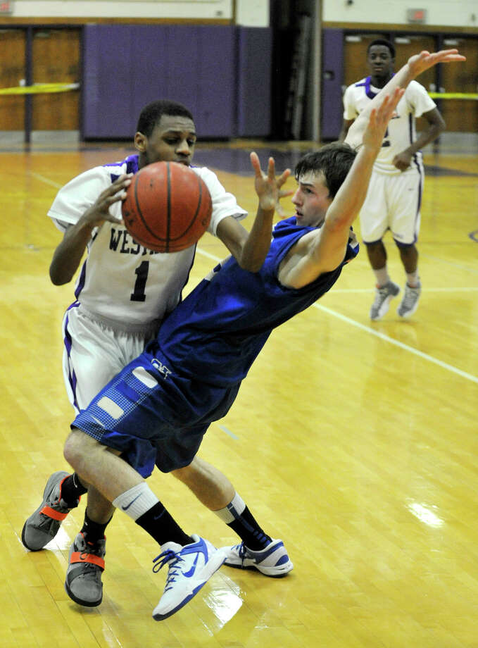 Westhill's Jeremiah Livingston tries to get around Newtown's Mike Daubert during their game at Westhill High School on Wednesday, March 6, 2013. Westhill won, 56-34. Photo: Jason Rearick / The Advocate