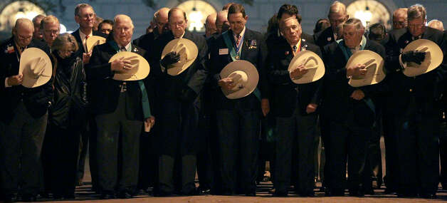 Members of the Sons of the Republic of Texas bow their heads in front of the Shrine of Texas Liberty during the Dawn at the Alamo ceremony. One hundred eighty-nine 189 Alamo defenders died in the March 6, 1836, battle and 300 to 500 Mexican soldiers were believed to have been killed. Photo: Photos By John Davenport / San Antonio Express-News