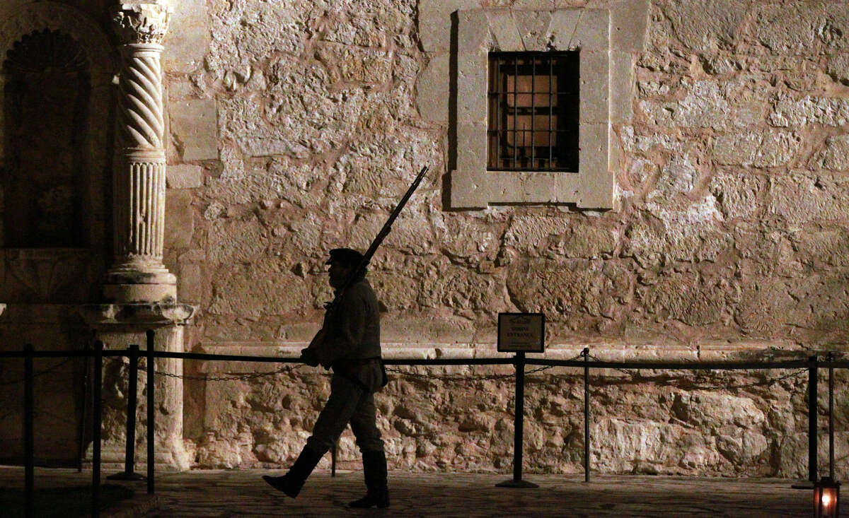 A member of the San Antonio Living History Association marches in front of the Alamo during the morning ceremony.