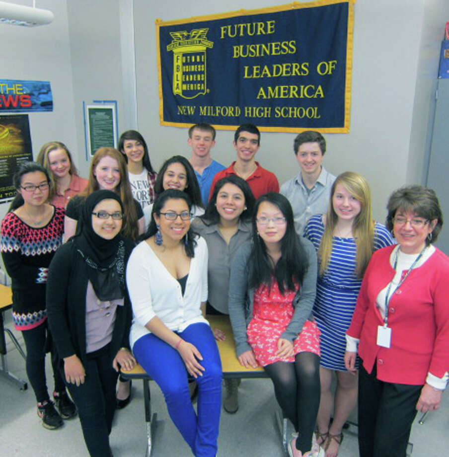 The Future Business Leaders of America chapter at New Milford High School will sponsor, in partnership with the Greater New Milford Chamber of Commerce, the first New Milford Spring Fair Days: a trade and craft show, April 27 at NMHS. The event will be open to the public. Teacher Janice Perrone, front right, is the advisor for the group. Among the members of the FBLA chapter at the school are, from left to right, in front, Shughla Ghafoor, Abigail Andrade, Jessica Carangui, Anna Lin and Sara Artese; middle row, Ada Lin, Sara Terry and Carolina Marchena; and back row, Anna Terry, Marina Leibowitz, Brian Terry, Kyle Kellett and Ryan Carmellini. For use in the Greater New Milford Chamber of Commerce Business Quarterly, March 2013. Photo: Deborah Rose