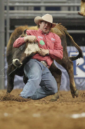 Nick Guy competes in Steer Wrestling during the BP Super Series IV Round 1 at Reliant Stadium on Wed