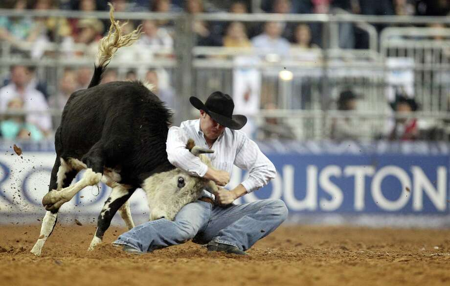 Tyler Waguespack competes in Steer Wrestling during the BP Super Series IV Round 1 at Reliant Stadium on Wednesday, March 6, 2013, in Houston. Photo: Mayra Beltran, Houston Chronicle / © 2013 Houston Chronicle