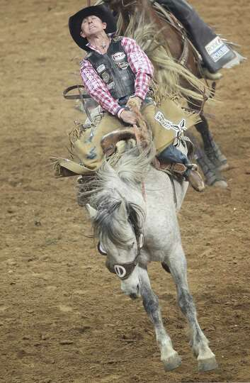 Luke Butterfield competes in Saddle Bronc Riding during the BP Super Series IV Round 1 at Reliant St