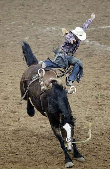 Rhys Angland competes in Saddle Bronc Riding during the BP Super Series IV Round 1 at Reliant Stadiu