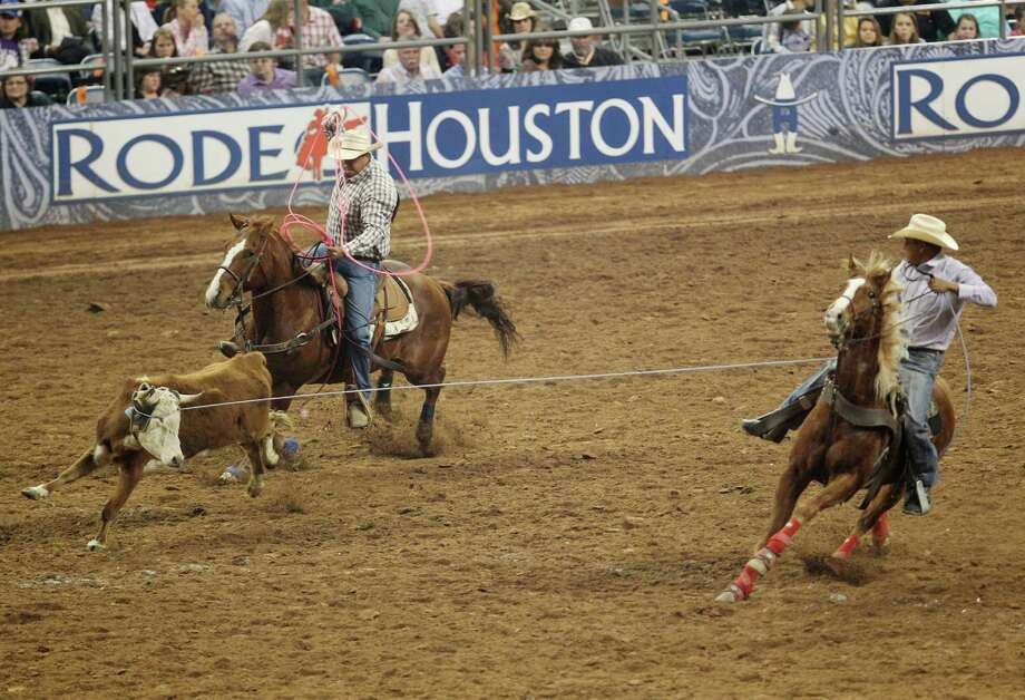 Brooks Dahozy and John Chaves compete in Team Roping during the BP Super Series IV Round 1 at Reliant Stadium on Wednesday, March 6, 2013, in Houston. Photo: Mayra Beltran, Houston Chronicle / © 2013 Houston Chronicle