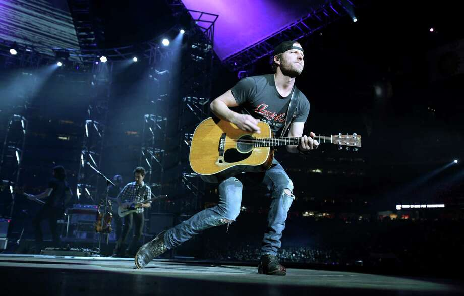 Dierks Bentley performs during the Houston Livestock Show and Rodeo at Reliant Stadium on Wednesday, March 6, 2013, in Houston. Photo: Mayra Beltran, Houston Chronicle / © 2013 Houston Chronicle