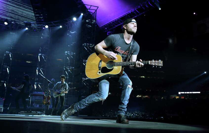 Dierks Bentley performs during the Houston Livestock Show and Rodeo at Reliant Stadium on Wednesday,