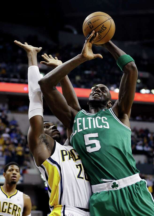 Boston Celtics' Kevin Garnett (5) shoots against Indiana Pacers' Ian Mahinmi (28) during the first half of an NBA basketball game Wednesday, March 6, 2013, in Indianapolis. (AP Photo/Darron Cummings) Photo: Darron Cummings