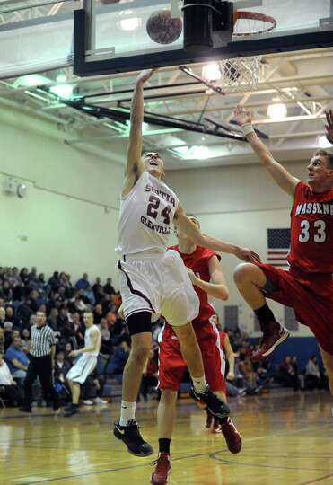Scotia's Joe Cremo goes in for a score during their Region 2 Class A Semi-Finals boy's basketball ga
