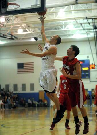 Scotia's Andrew Tabbert goes in for a score their Region 2 Class A Semi-Finals boy's basketball game against Massena on Wednesday March 6, 2013 in Saratoga Springs, N.Y. (Michael P. Farrell/Times Union) Photo: Michael P. Farrell