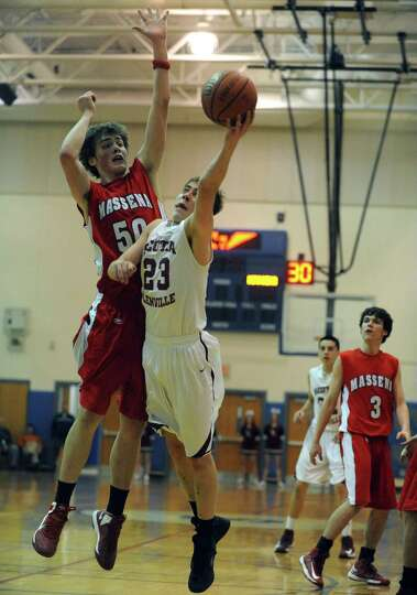 Scotia's Alex Sausville goes in for a score during their Region 2 Class A Semi-Finals boy's basketba