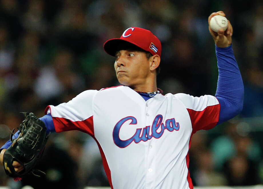Cuba's starter Wilber Perez delivers a pitch against Japan in the first inning of their World Baseball Classic first round game in Fukuoka, Japan, Wednesday, March 6, 2013. (AP Photo/Koji Sasahara) Photo: Koji Sasahara