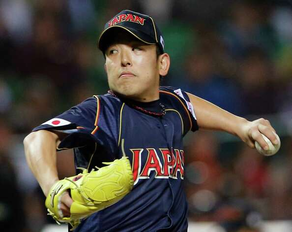 Japan's starter Kenji Otonari delivers a pitch against Cuba in the first inning of their World Baseball Classic first round game in Fukuoka, Japan, Wednesday, March 6, 2013. (AP Photo/Koji Sasahara) Photo: Koji Sasahara