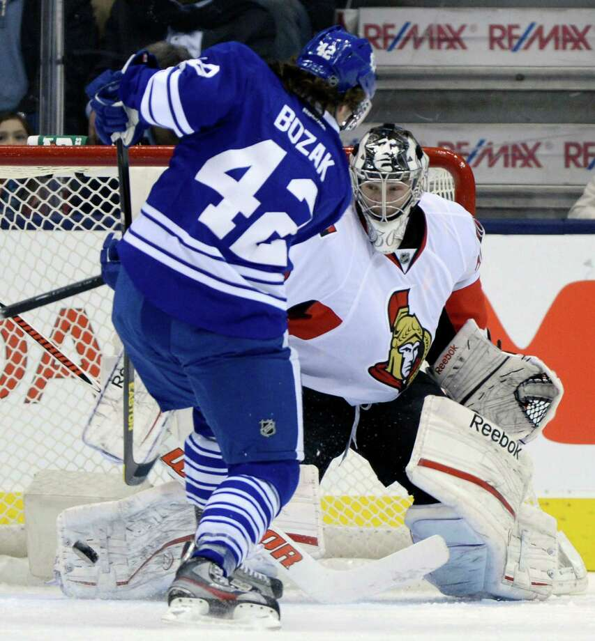 Toronto Maple Leafs centre Tyler Bozak (42) scores on Ottawa Senators goalie Ben Bishop during first-period NHL hockey game action in Toronto, Wednesday, March 6, 2013. (AP Photo/The Canadian Press, Frank Gunn) Photo: Frank Gunn