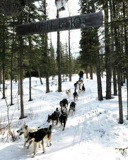 In this March 5, 2013 photo, Iditarod rookie Christine Roalofs arrives at the Rohn checkpoint in Ala