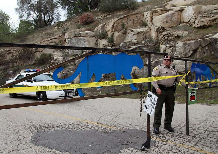 An officer guards the gate near at the entrance of Cat Haven, the exotic animal park in central California where a 26-year old female volunteer intern was killed by a lion, Wednesday, March 6, 2013 in Dunlap, Calif. (AP Photo/Gosia Wozniacka) Photo: Gosia Wozniacka, Associated Press