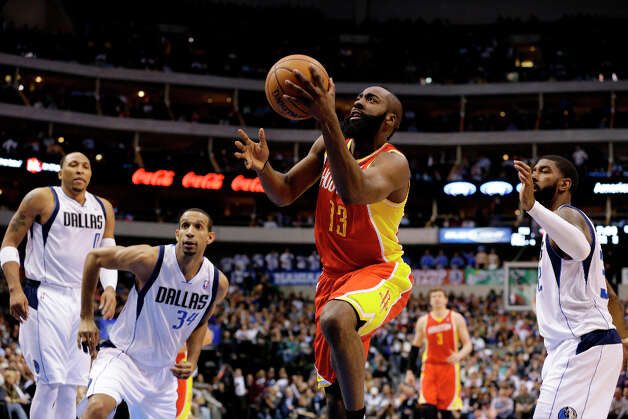 James Harden goes up for a shot after getting by Shawn Marion, Brandan Wright and O.J. Mayo. Photo: Tony Gutierrez, Associated Press / AP