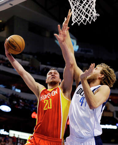 March 6: Mavericks 112, Rockets 108Rockets forward Donatas Motiejunas shoots as Dirk Nowitzki defends. Photo: Tony Gutierrez, Associated Press / AP