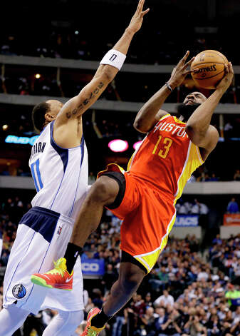 James Harden is fouled by Shawn Marion while attempting a shot. Photo: Tony Gutierrez, Associated Press / AP