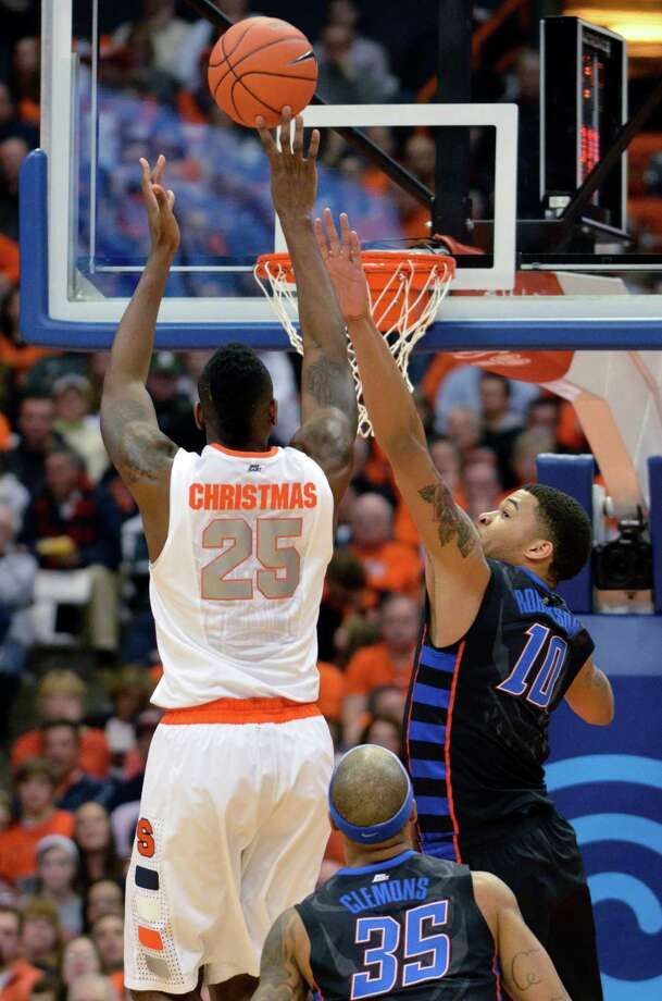 Syracuse's Rakeem Christmas scores against DePaul's Derrell Robertson during the first half of an NCAA college basketball game in Syracuse, N.Y., Wednesday, March 6, 2013. (AP Photo/Kevin Rivoli) Photo: Kevin Rivoli