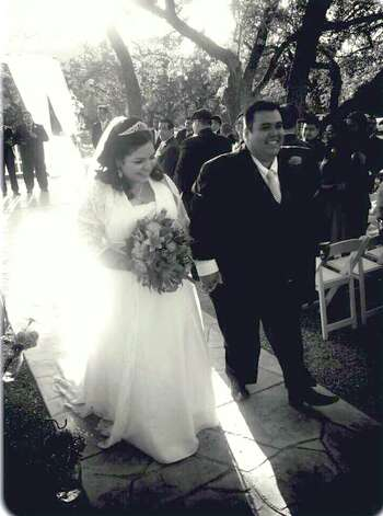 Bride Benita Veliz with her groom, the Rev. Josue Holguin at their wedding. He's from Laredo. Photo: Courtesy Photo