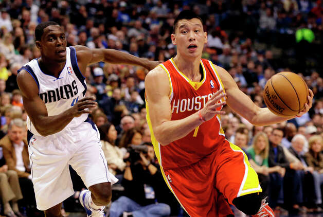 Rockets guard Jeremy Lin drives by Darren Collison in the first half. Photo: Tony Gutierrez, Associated Press / AP