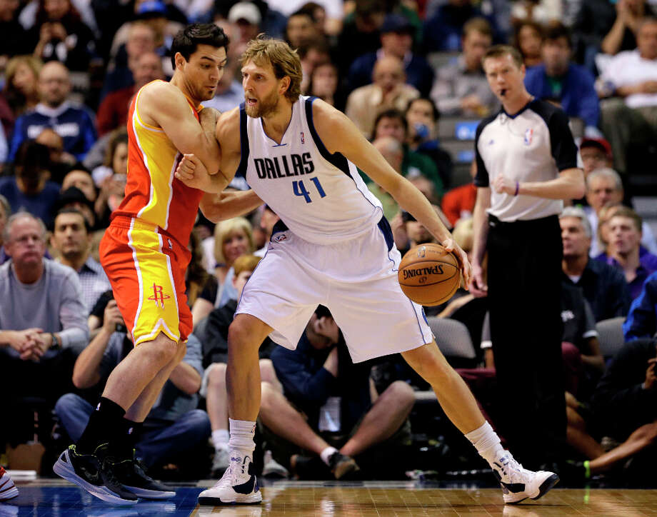 Carlos Delfino defends as Dirk Nowitzki looks for a shot. Photo: Tony Gutierrez, Associated Press / AP