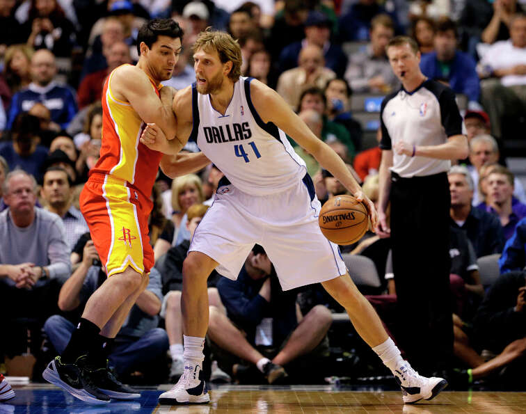 Carlos Delfino defends as Dirk Nowitzki looks for a shot.