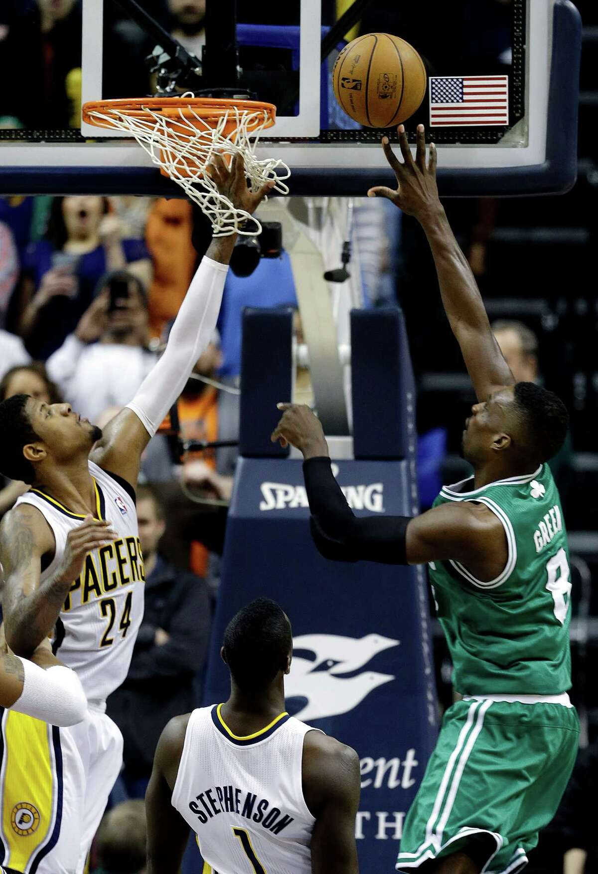 Boston's Jeff Green, right, makes the last-second, game-winning basket against Indiana on Wednesday.