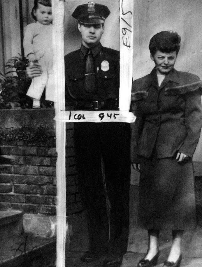 A photo of Officer Frank Hardy, who was killed in the March 12, 1954, Greenwood bank robbery, in a picture with his family. The marks were made by a P-I photo editor for the March 13 newspaper, and the photo was preserved in the newspaper photo archive.