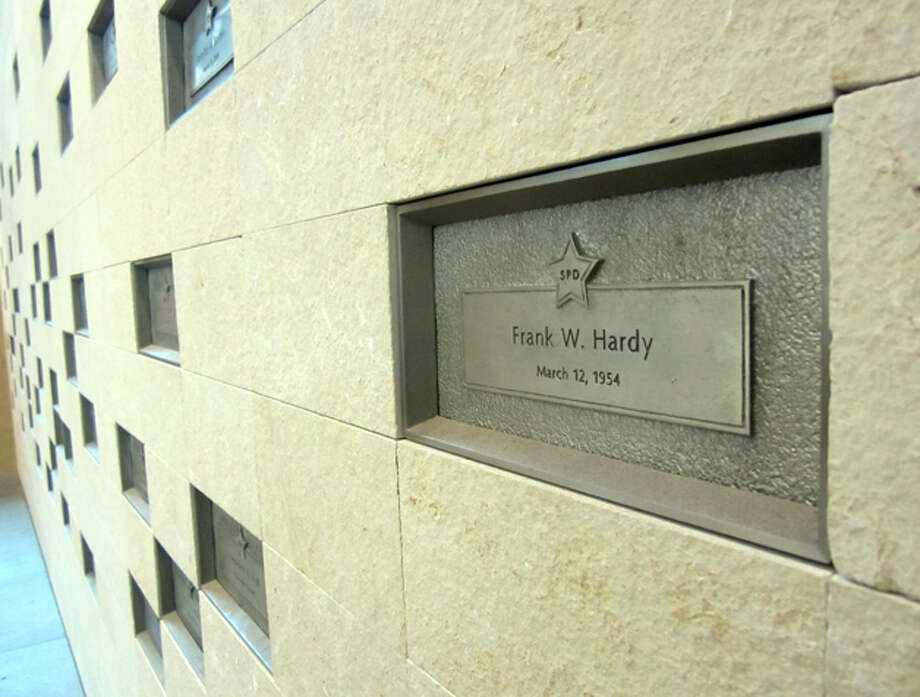 The marker for Frank W. Hardy, who was shot to death at age 30 when responding to a Greenwood bank robbery, March 12, 1954. This marker is on the wall of honor at police department headquarters. Hardy is one of 58 Seattle officers who have died in the line of duty.