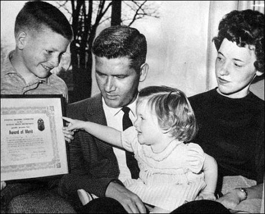 Police officer Vernon Chase is shown with his family, including son Jimmy and daughter Karen, on April 26, 1962.