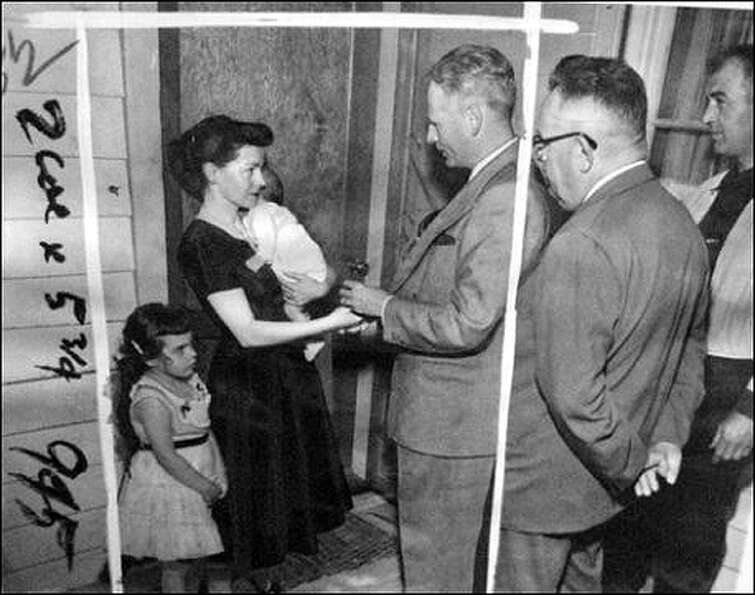 In July 1954, Seattle Police Chief H. James Lawrence presented keys to Rolene Hardy. Police officers
