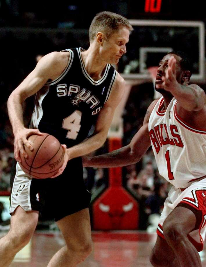 Chicago Bulls Randy Brown (1) defends his teammate from last year, Steve Kerr (4) of the San Antonio Spurs, during the first quarter Sunday, Feb. 14, 1999, at the United Center. Kerr, who helped lead the Bulls to their sixth NBA title in 1998, was presented his championship ring in a pre-game ceremony. (AP Photo/Michael S. Green) DIGITAL CAMERA IMAGE  Ran on: 08-07-2004 Allen Iverson is capable of the spectacular, but hitting the perimeter shot is not one of his strengths. Photo: Michael S. Green, Associated Press