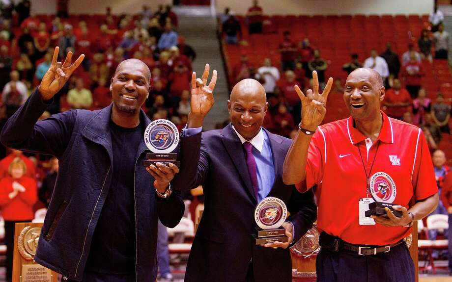 The Cougar pride still flows from Hakeem Olajuwon, left, Clyde Drexler, center, and Elvin Hayes, who were honored Wednesday night at Hofheinz Pavilion for their selection to the NCAA Tournament's 75th-anniversary team. Photo: Billy Smith II, Staff / © 2013 Houston Chronicle
