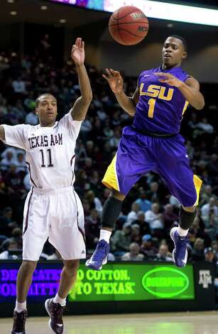 LSU's Anthony Hickey passes over Texas A&M's J'Mychal Reese during the second half of an NCAA college basketball game in College Station, Texas on Wednesday, March 6, 2013. (AP Photo/Bryan-College Station Eagle, Stuart Villanueva) Photo: Stuart Villanueva, Associated Press / Bryan College Station Eagle