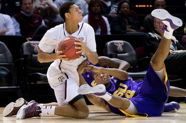 Texas A&M's Jordan Green comes up with the ball against LSU's Corban Collins during the second half of an NCAA college basketball game in College Station, Texas on Wednesday, March 6, 2013. (AP Photo/Bryan-College Station Eagle, Stuart Villanueva) Photo: Stuart Villanueva, Associated Press / Bryan College Station Eagle