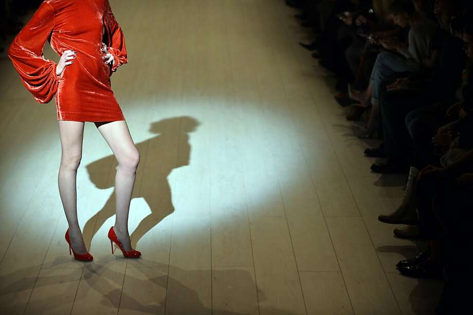 Red alert:A model wears a creation by Ukrainian fashion designer Victoria Gres during the opening of Ukrainian Fashion Week in Kiev. Photo: Sergei Supinsky, AFP/Getty Images